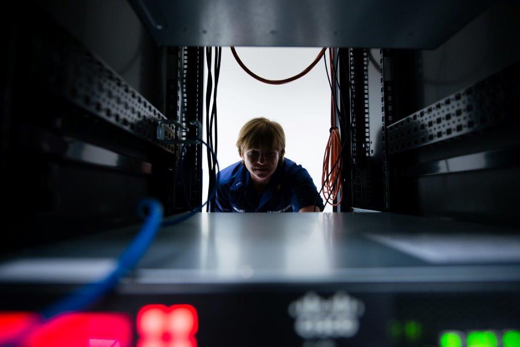 Person looking between two computer desktops