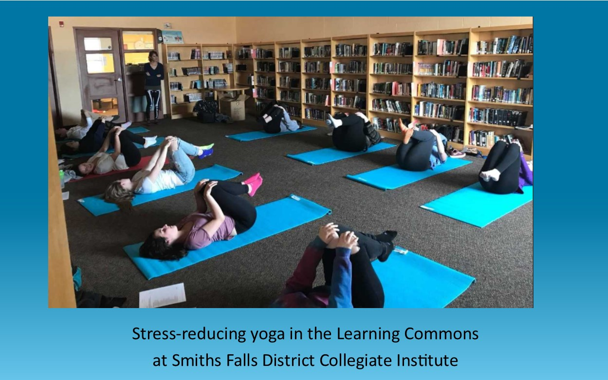 Students from SFDCI doing yoga on yoga mats in the Learning Commons