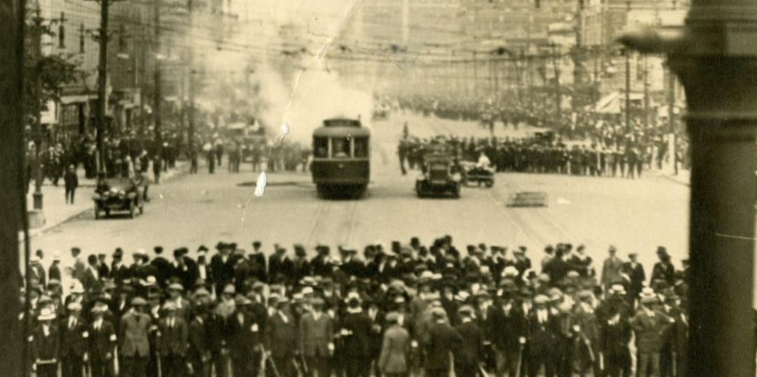 A photograph of a streetcar on fire surrounded by crowds on Bloody Saturday (June 21, 1919) during the Winnipeg General Strike. Source: Pitblado Family fonds.