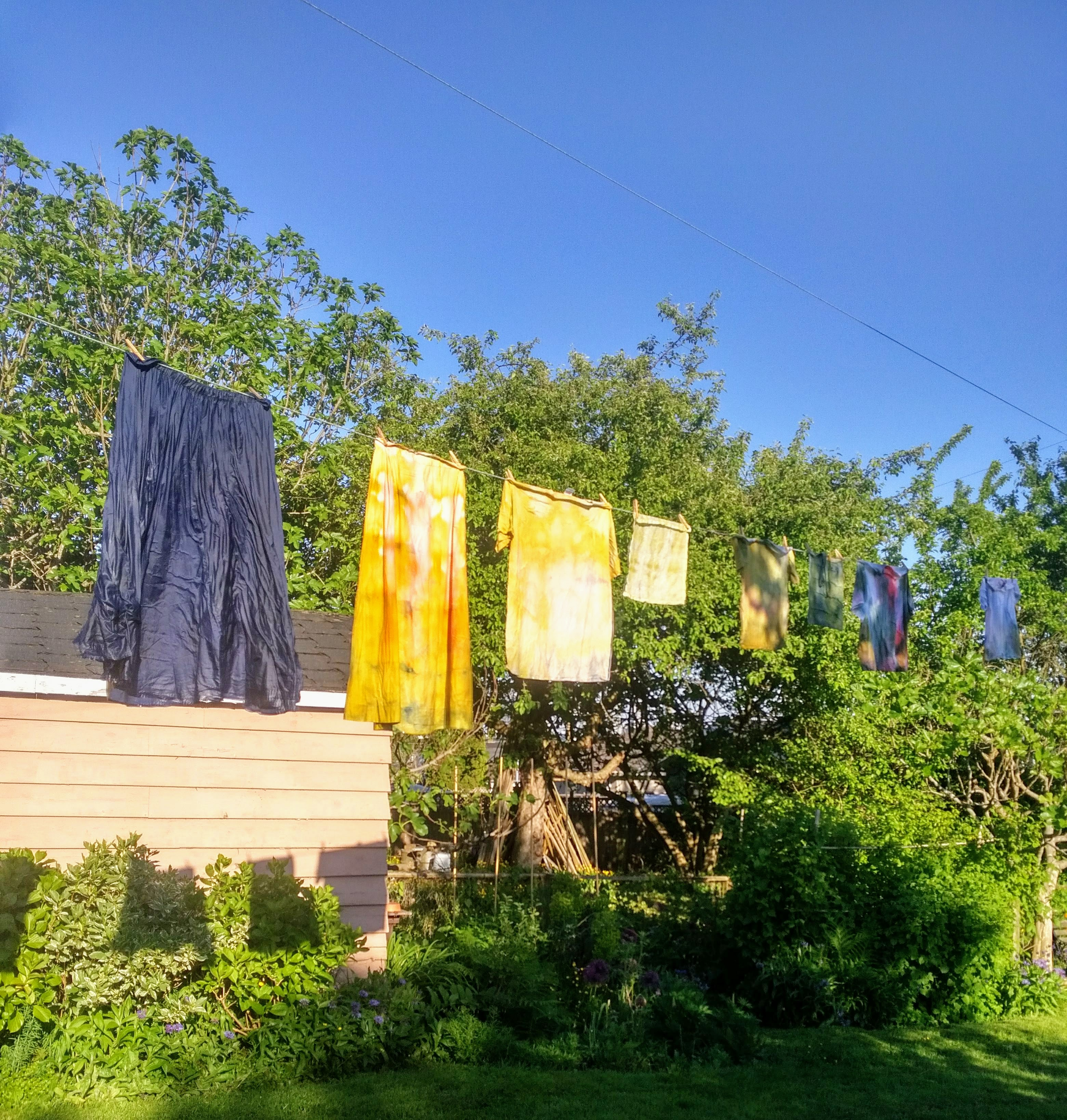 tie dyed clothing on clothesline