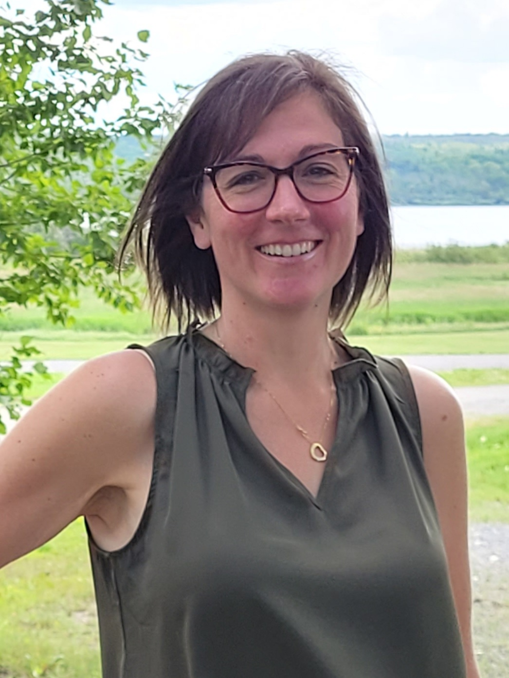 Woman with short brown hair and glasses
