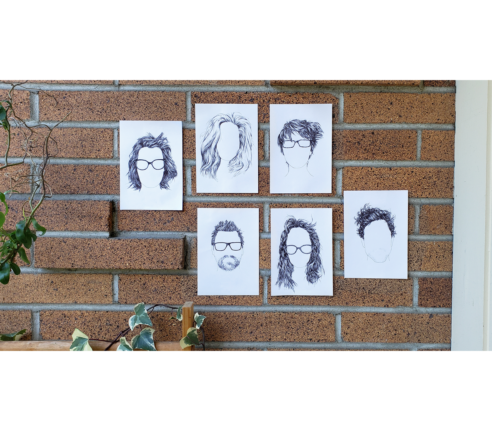 six line drawings of wild morning hair taped on a brick wall, glasses included but faces blank