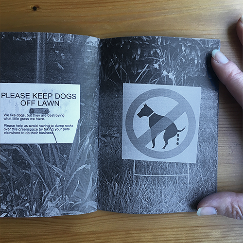 interior of hand-sized zine composed of photographs of anti dog-poo signs