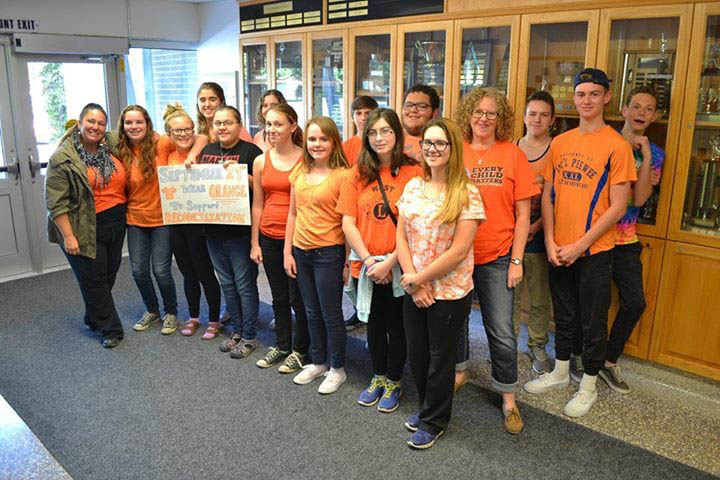 Rideau District High School students in orange shirts