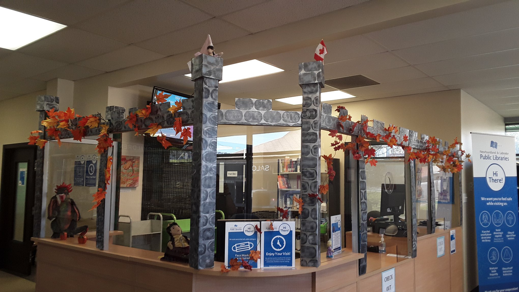 Circulation  desk decorated as a castle at the Marjorie Mews Public Library