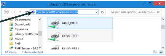 File Explorer window with an arrow pointing to the address bar, showing \\ndacprint01.academic.rrc.ca