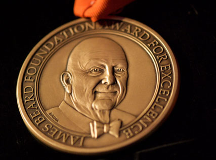 "Image of medallion inscribed with the bust of James Beard and the words ""James Beard Foundation Award for Excellence""."