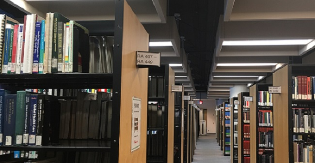 Image of library shelves with focus on RA 407 - RA 449 call number range