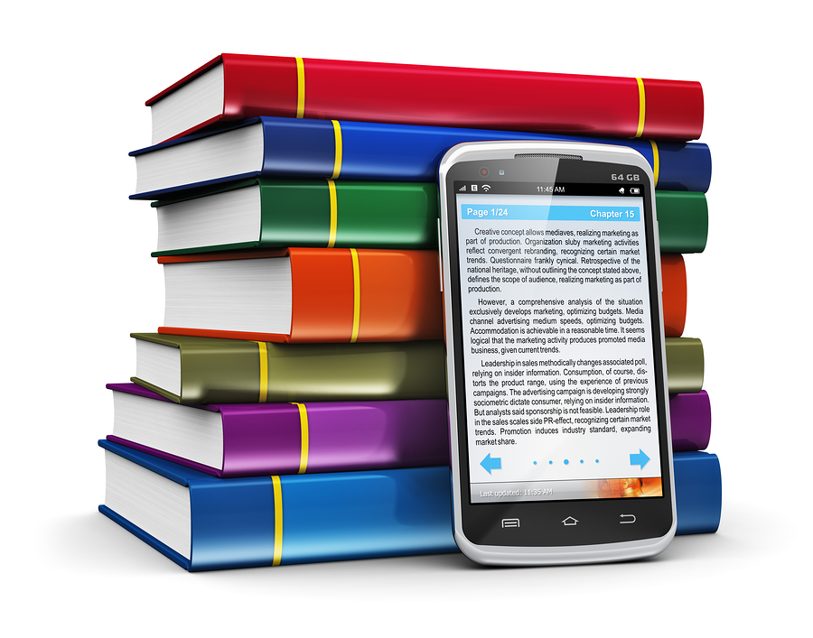 Stack of books with smartphone in front