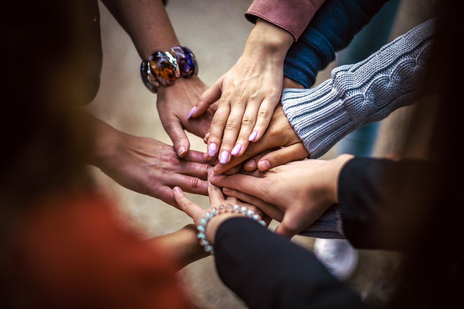 Circle of people touching hands