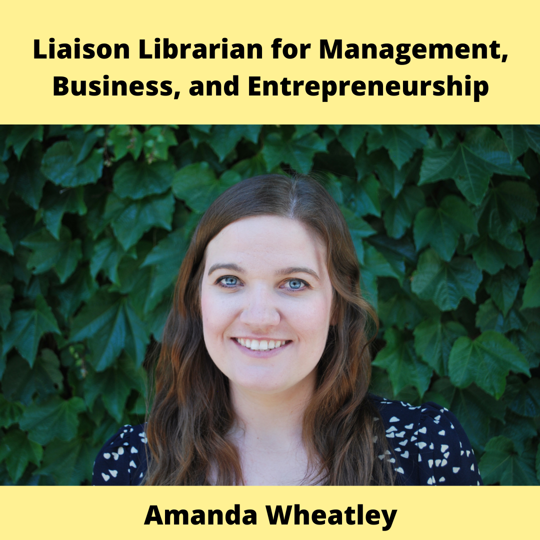 Liaison Librarian for Management, Business, and Entrepreneurship - Amanda Wheatley. Young woman with long brown hair stands in front of an ivy covered wall.