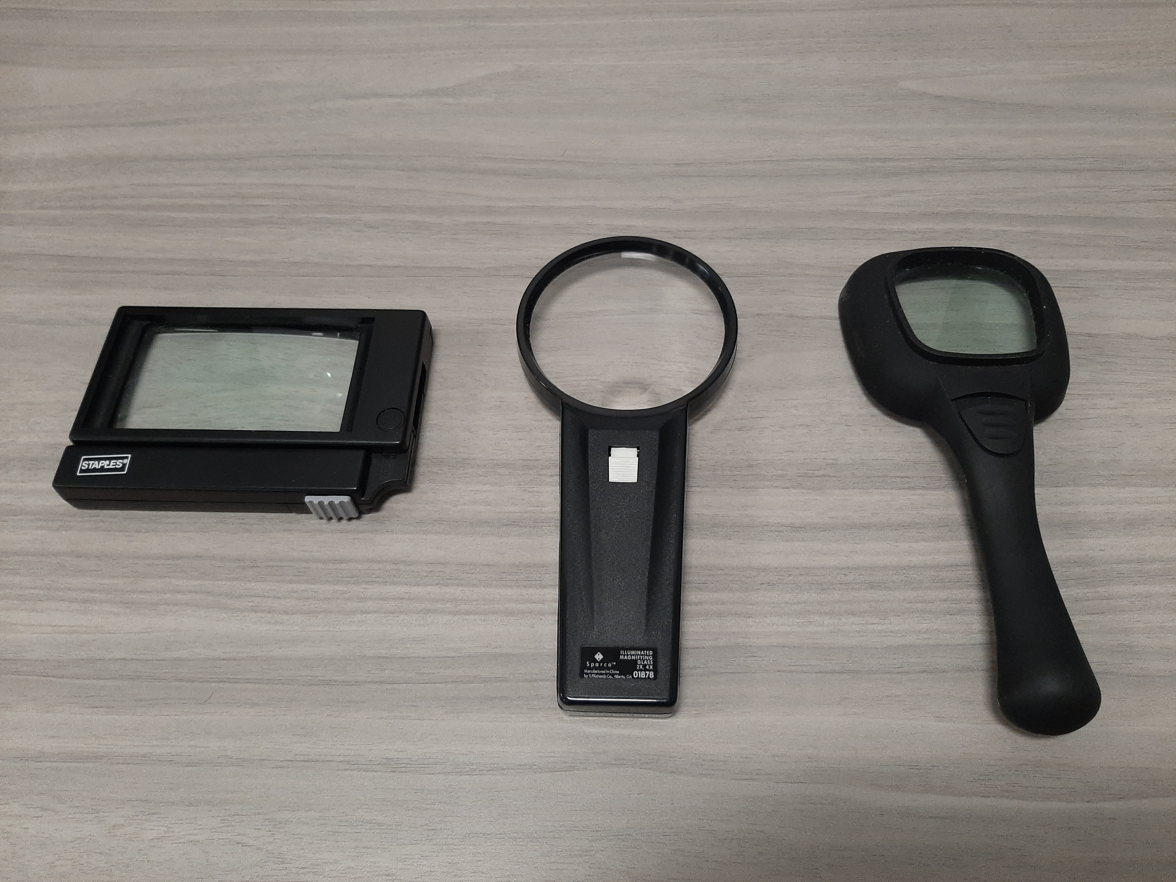 three different handheld magnifiers