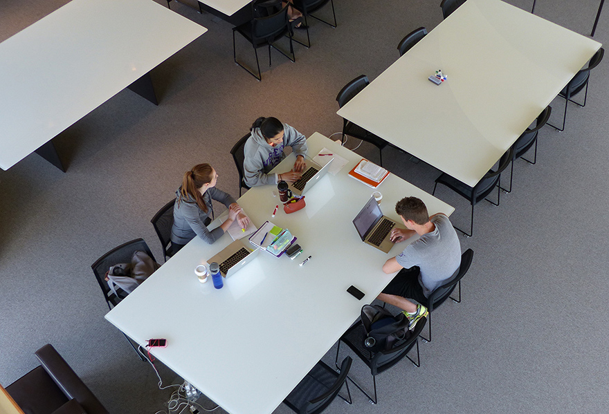 students using whiteboard table