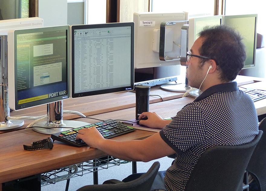 student using Bloomberg workstation