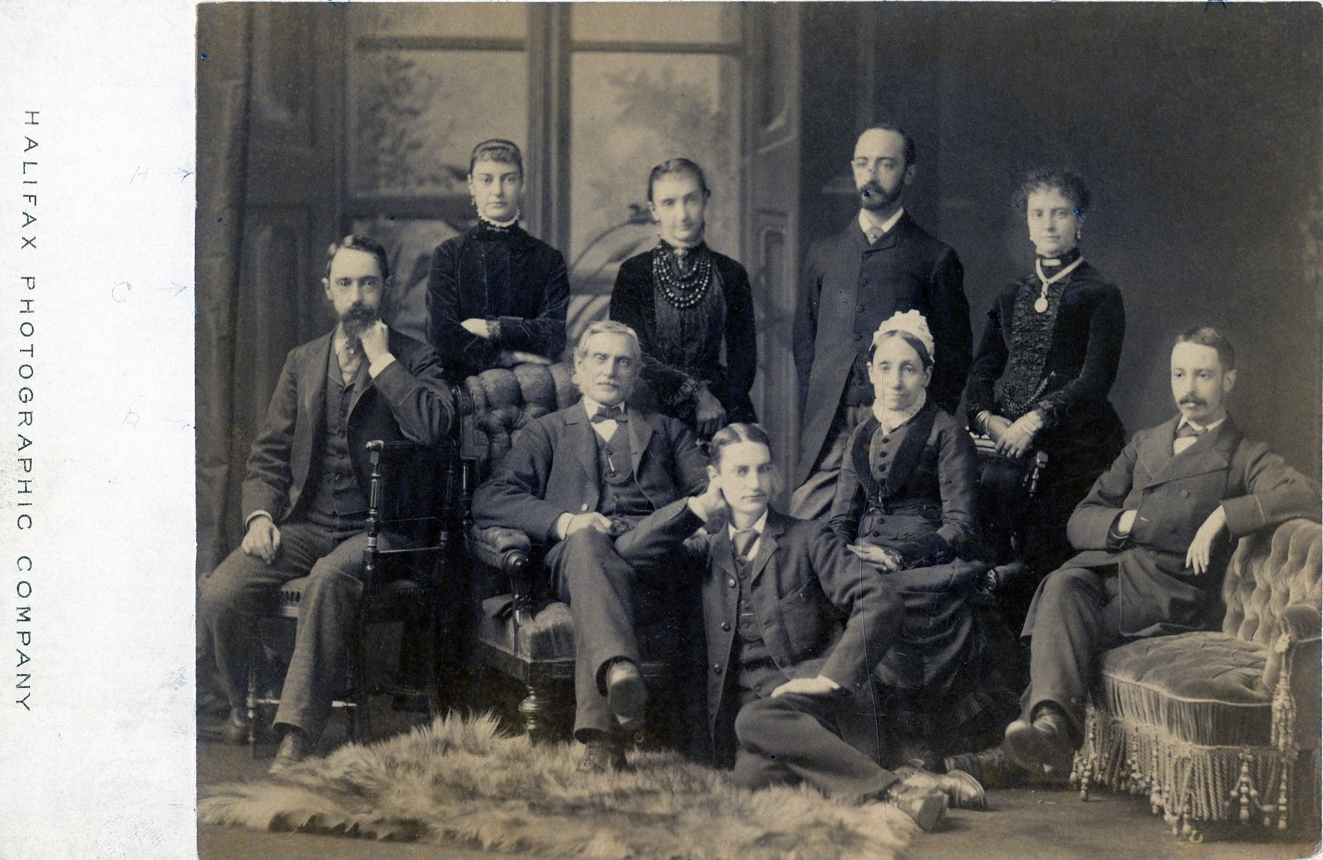 Nine members of the Bell family taking a family photograph.