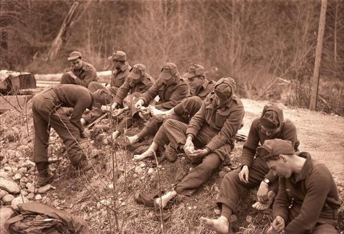 Group of soldiers caring for their feet