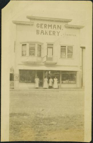 Man & Women Standing at German Bakery