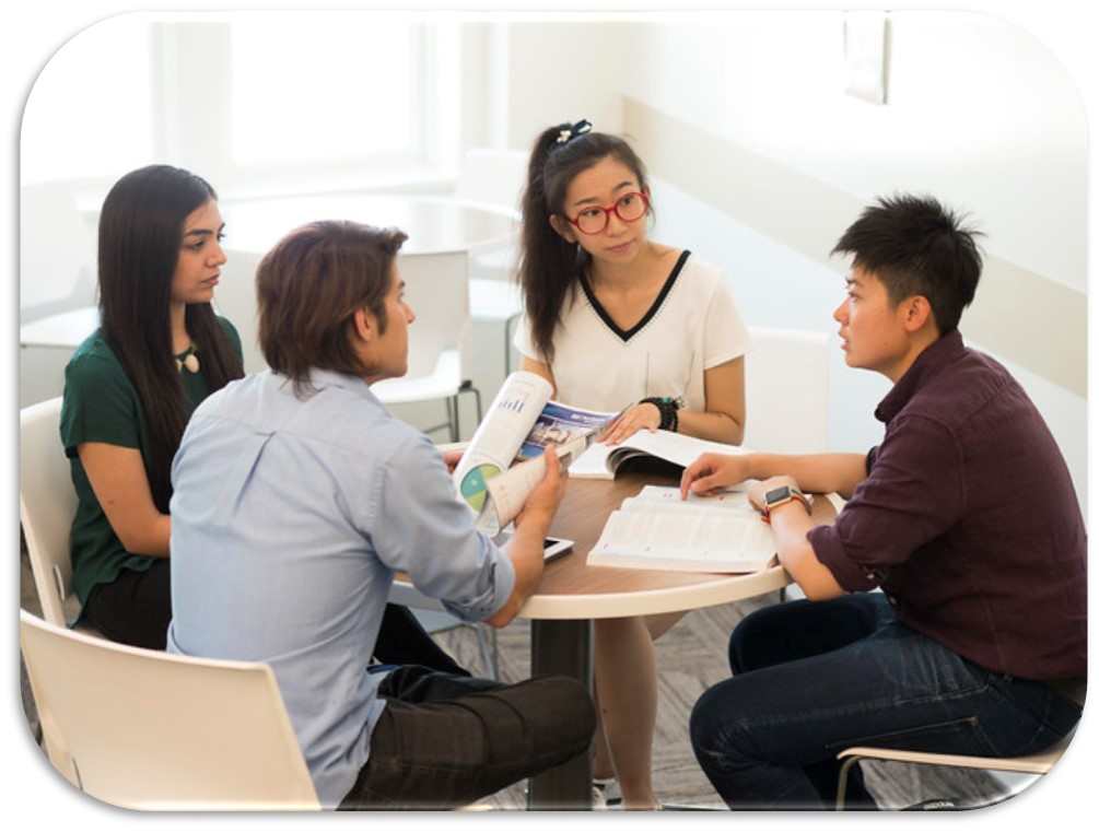 Picture of students talking around a table