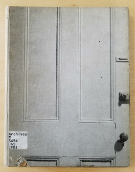 "The front cover of Michael Snow's ""Cover to Cover,"" with a black and white photograph of a closed white door with no text."