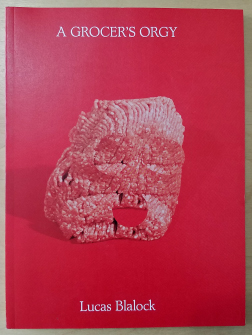Red cover with white title. Ground meat in center with 3 cutout circles.