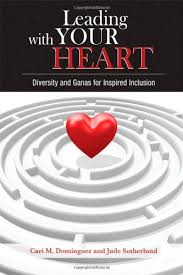 A white background with a circular grey maze with a red heart floating above it's center.