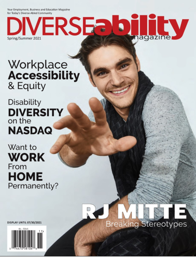 RJ Mitte, a masculine presenting actor, reaching out and smiling out at the viewer.