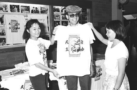 three students wearing shirts for Chinese democracy