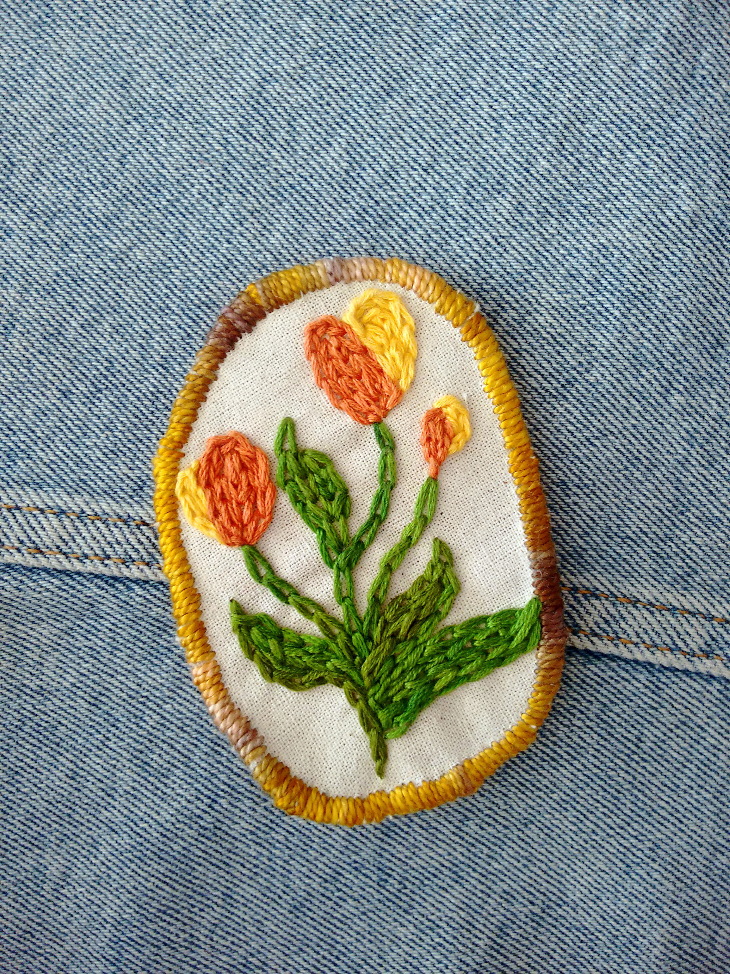 Embroidered tulip patch with a yellow trim