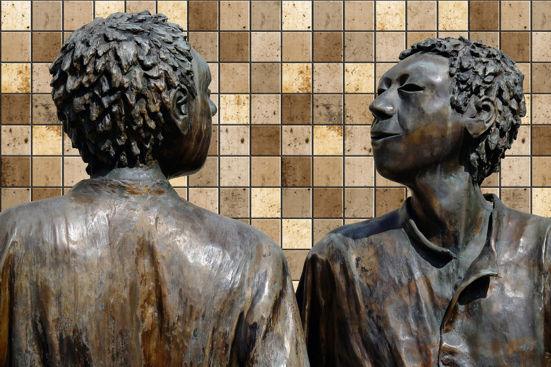 Bronze sculpture of two people looking at each other