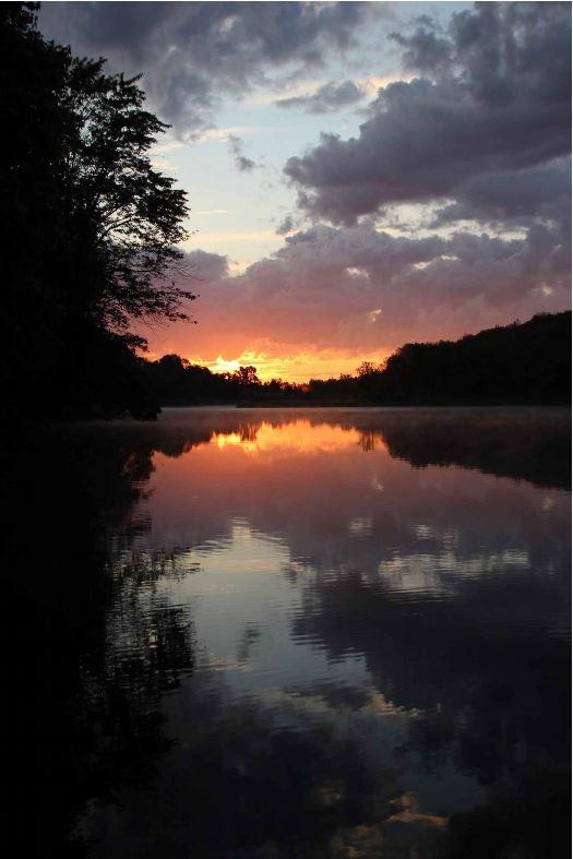 Book cover image of a calm lake at sunrise