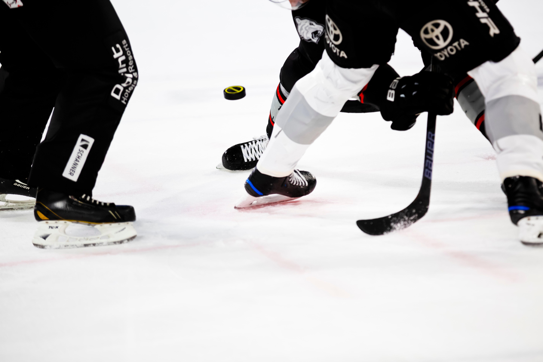 Image of people playing hockey