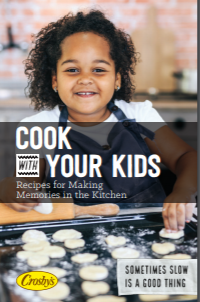 Cook book cover depicting child baking cookies