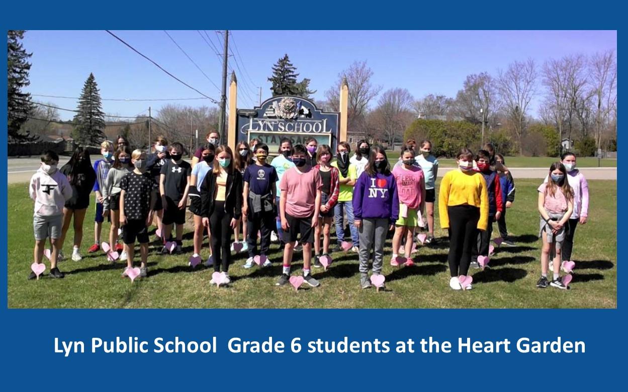 Group of students standing in the Lyn Public School Heart Garden