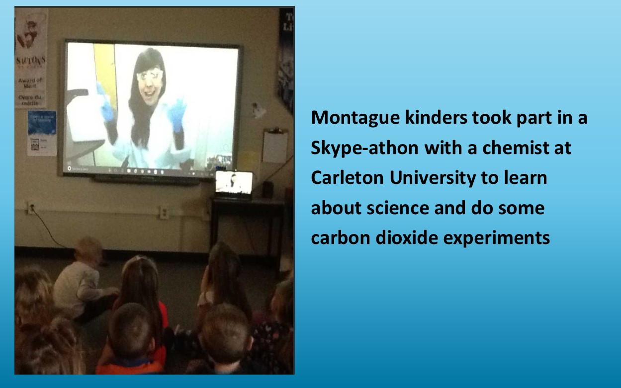 Children watching a skype of a scientist from Carleton University.