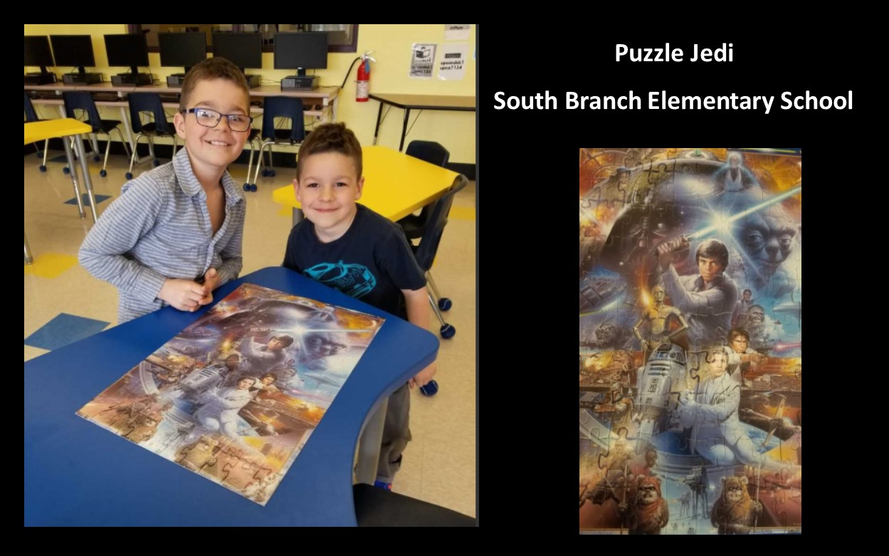 Two brothers beside the Star Wars puzzle that they built together.