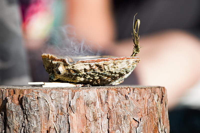 smudge bowl on a tree stump