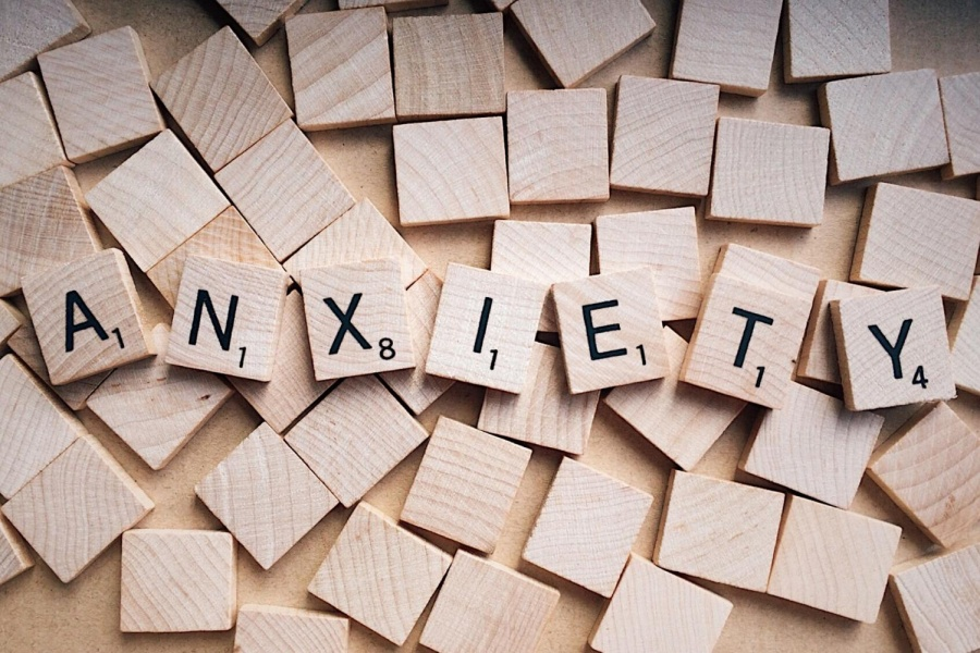 scrabble tiles spelling out the word anxiety