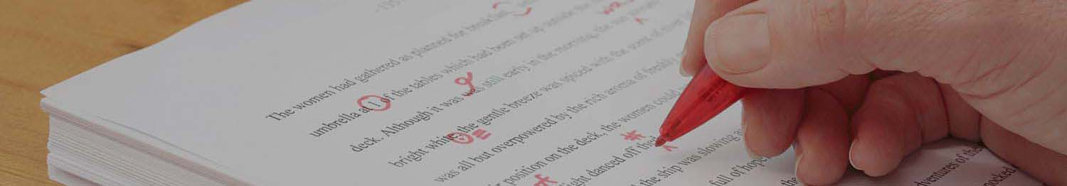 hand on paper correcting grammar with circles