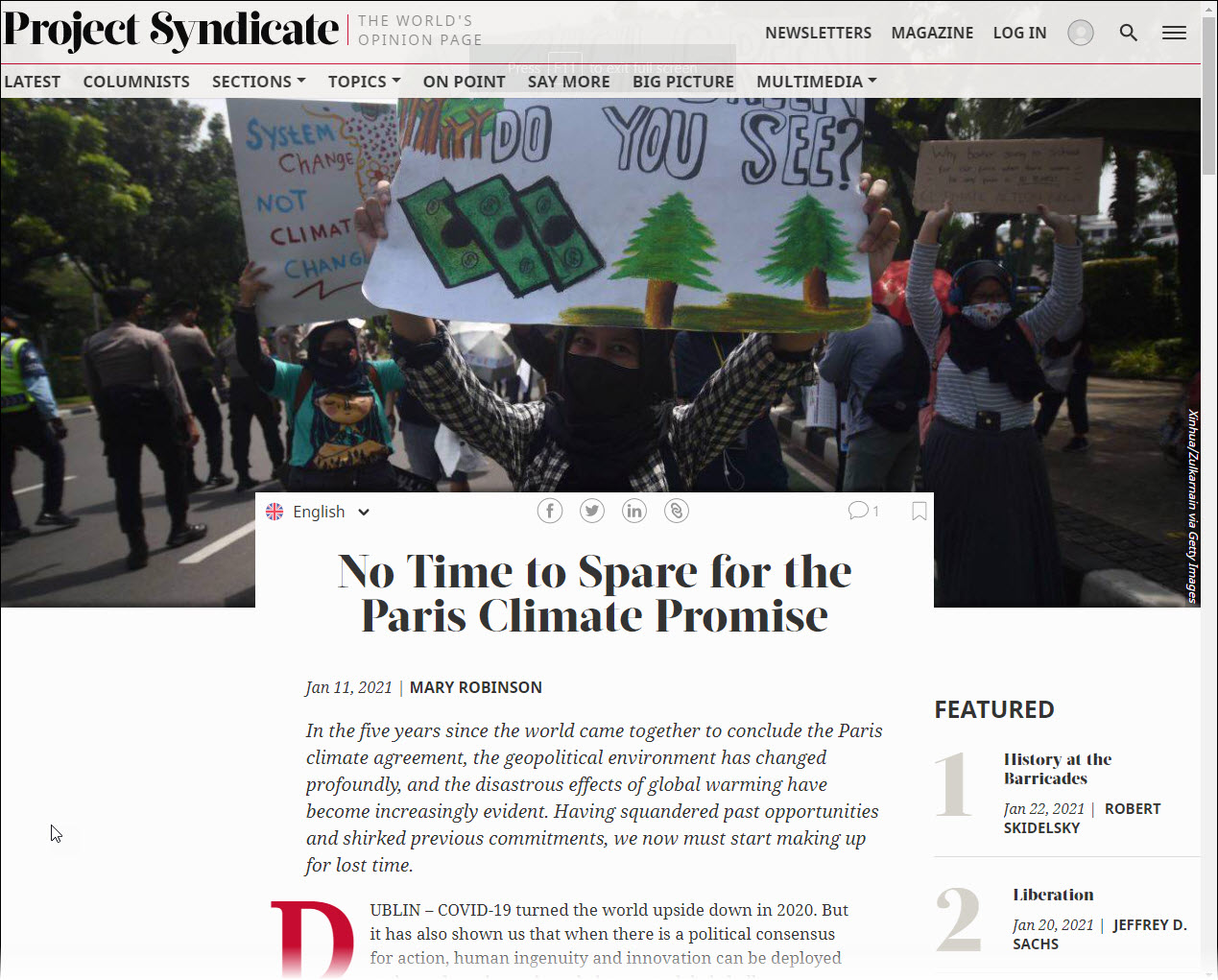 """Project Syndicate piece by Mary Robinson: """"No Time to Spare for the Paris Climate Promise"""" with accompanying photo of protestors with signs."""