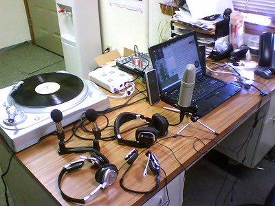 Mini-recording studio image with mics, turntable, computer