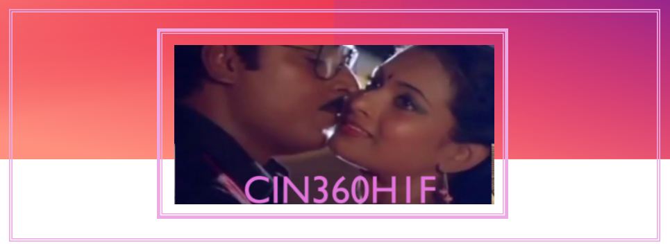 Screenshot of Indian couple about to kiss from film with colourful background