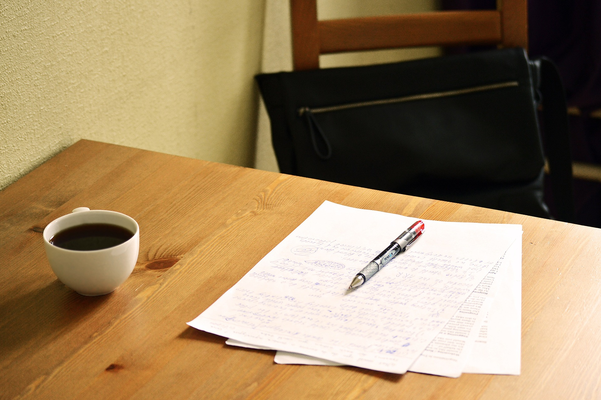 Paper on a desk with a pen on top