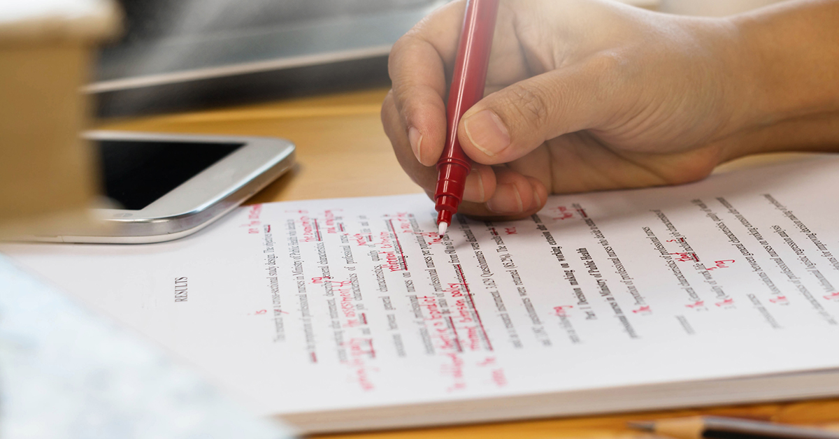 Editor marking up a text with a red pen
