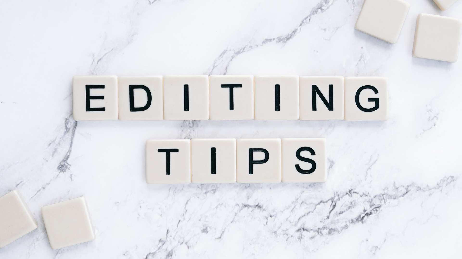 Letter tiles that spell out editing tips