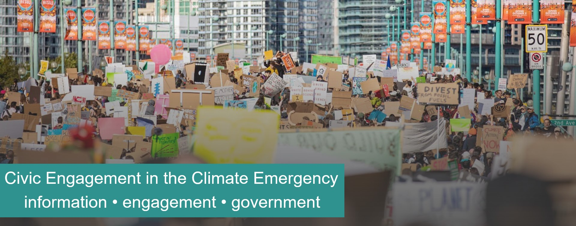 Sept 28 2019 protestors marching across Cambie Bridge in Vancouver with the text: Civic Engagement in the Climate Emergency. Information, engagement, government.