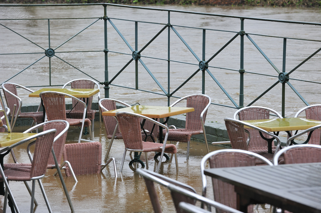 Flooded brook and terrace of restaurant at Nederzwalm