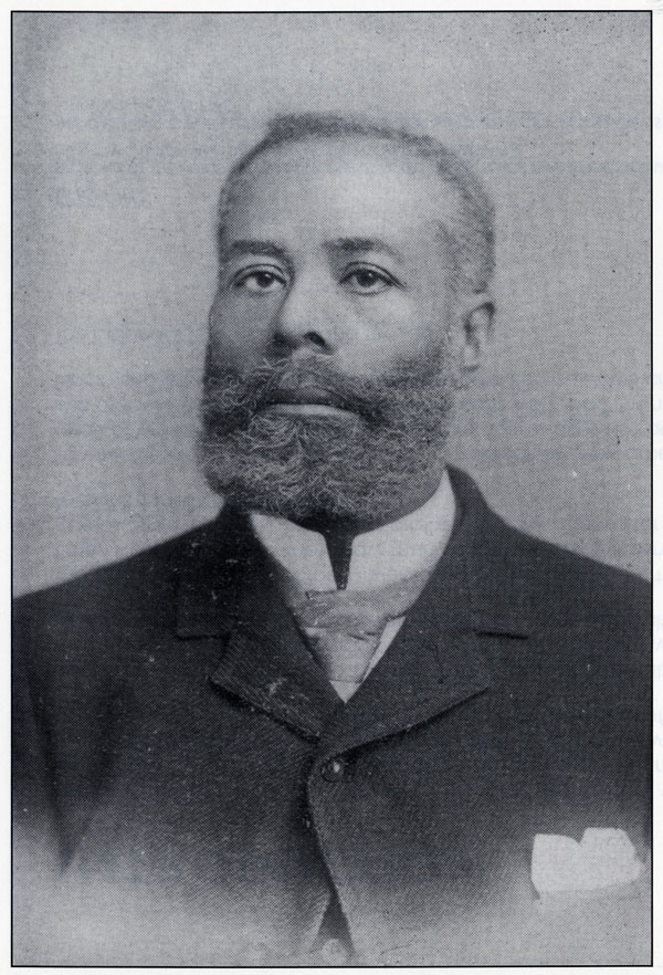 Black and white portrait photograph of Black Canadian Elijah McCoy