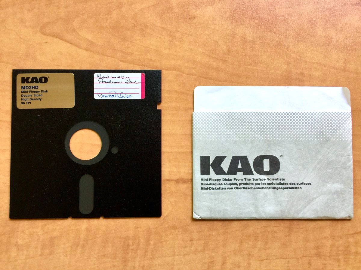 Image of a floppy disk with accompanying paper holder