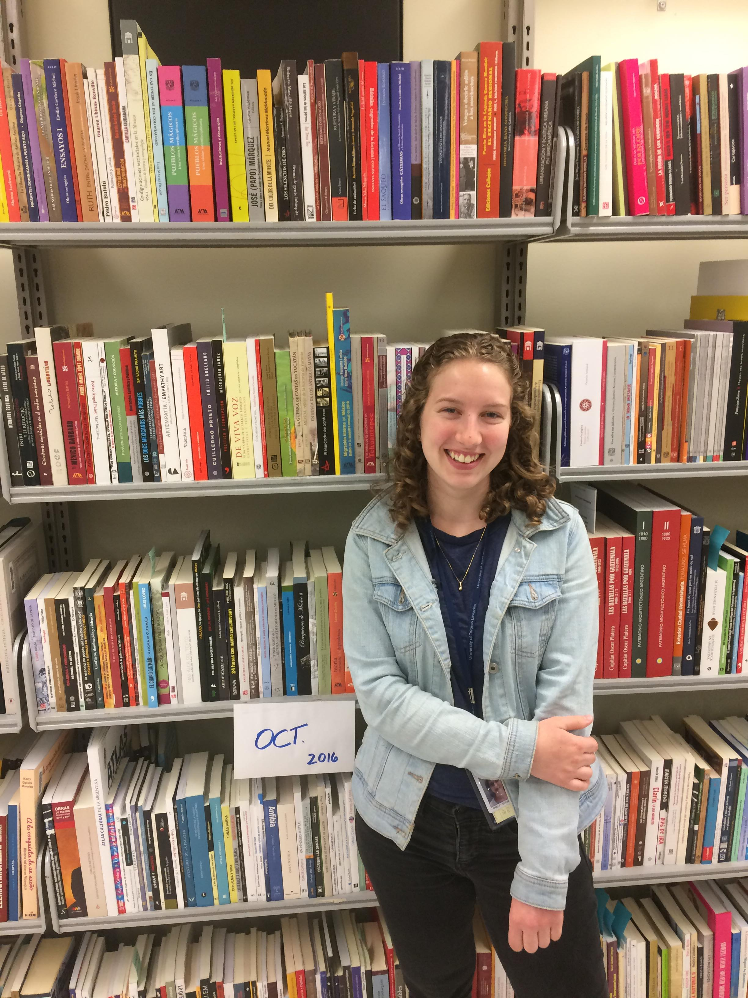 Shelby Stinnissen standing in front of book shelves