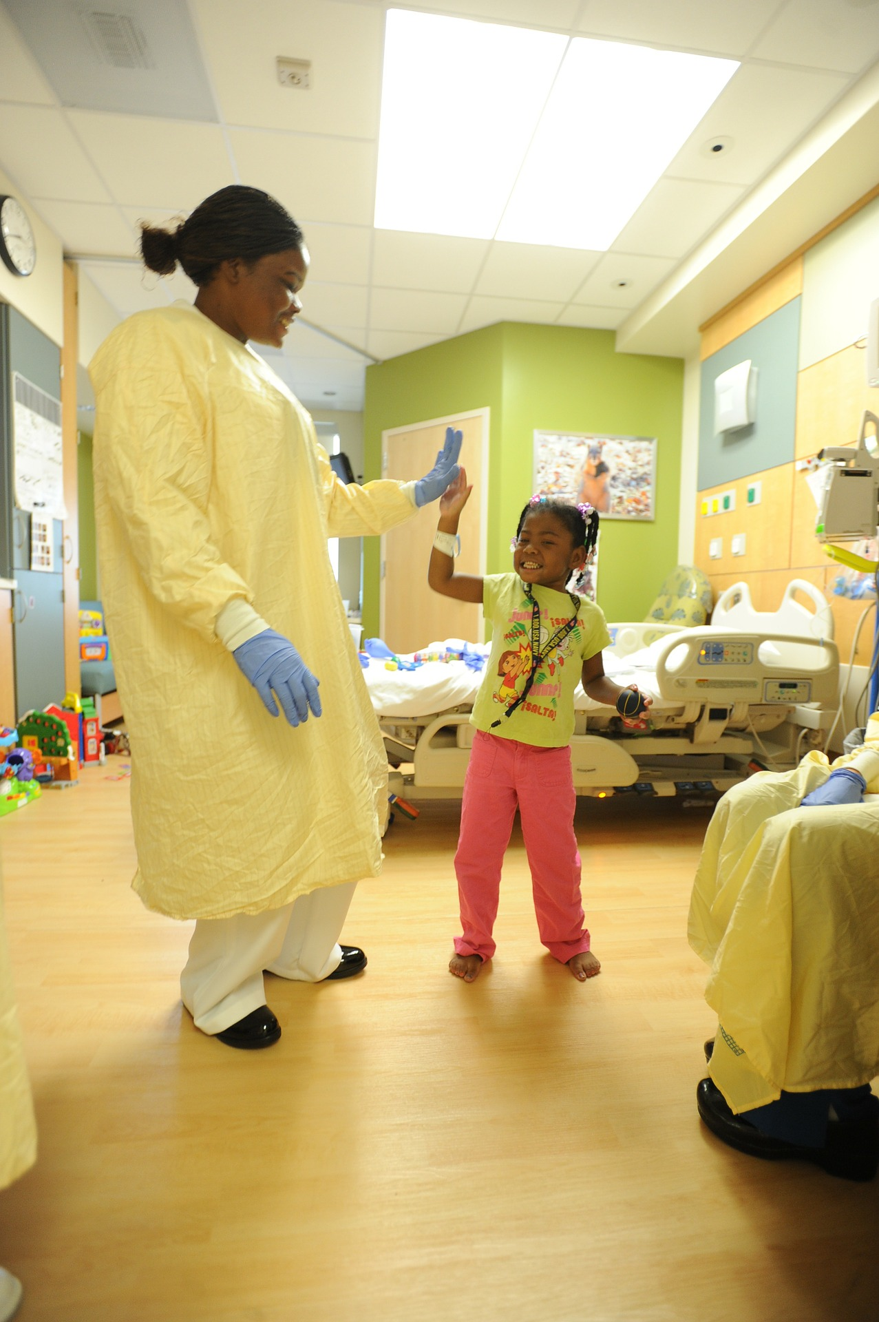 Healthcare worker in pediatric ward interacting with patient